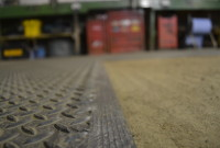 Close up on partial flooring of Garage
