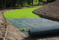 TurfProtecta Grass Mesh for Turf and Lawn Reinforcement - Install rolling